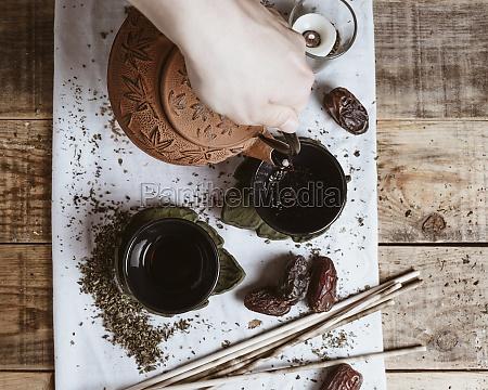 hand serving fragrant tasty tea in