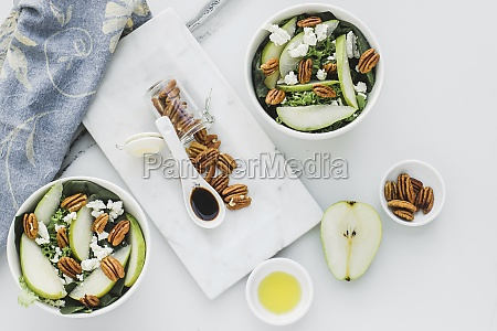 served bowls with cut pears and