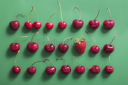 an arrangement of cherries and one