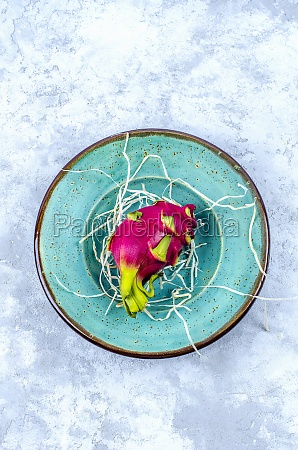 dragon fruit on a turquoise craft