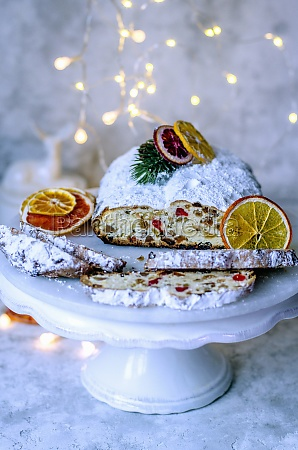 christmas stollen on a white stand