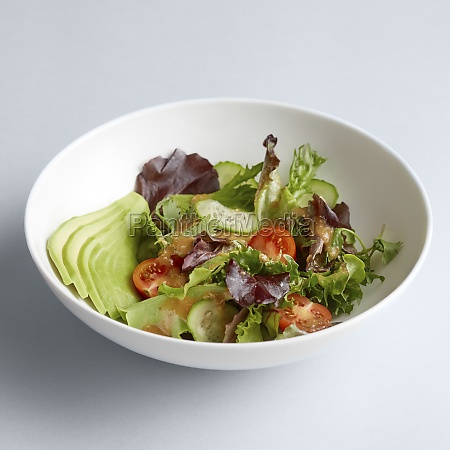 a mixed salad with cucumber and