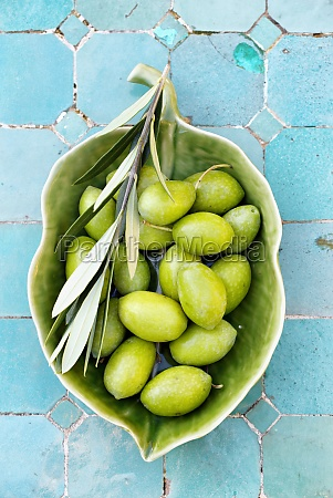 green olives with a branch in