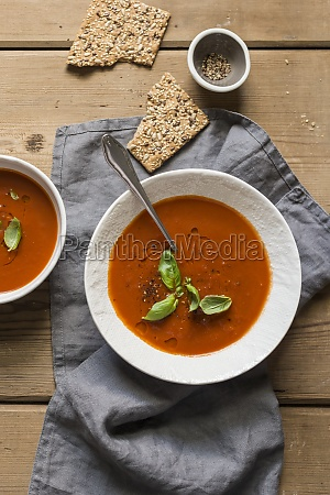 tomato soup with fresh basil on