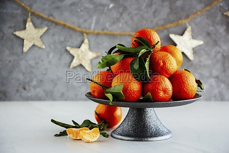 ripe tangerines citrus fruits with leaves