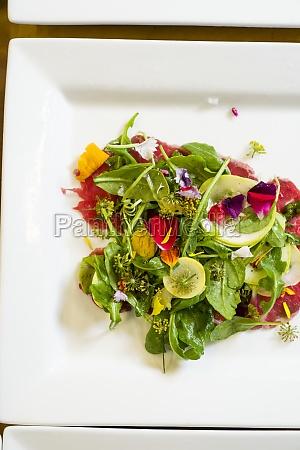 beautiful greens salad with vibrant edible