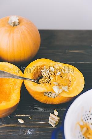 a pumpkin being deseeded
