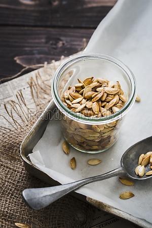 a jar of roasted pumpkin seeds
