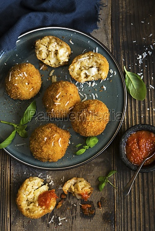 arancini balls with mozzerella filling and