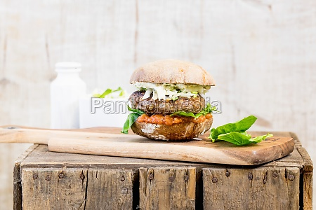 a burger with coleslaw on a