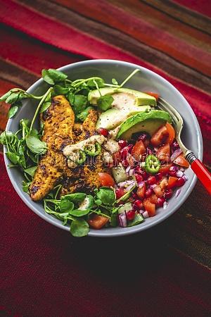 tandoori chicken bowl with avocado