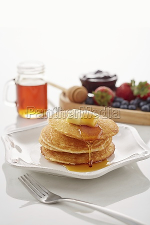 classic pancakes with butter and honey