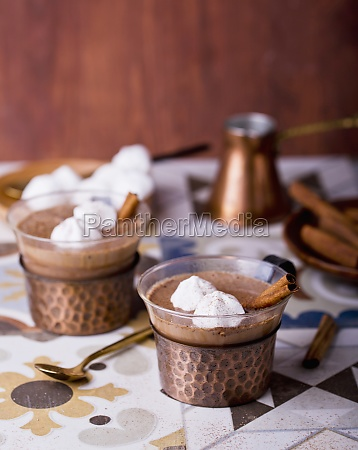 hot chocolate garnished with meringue dots
