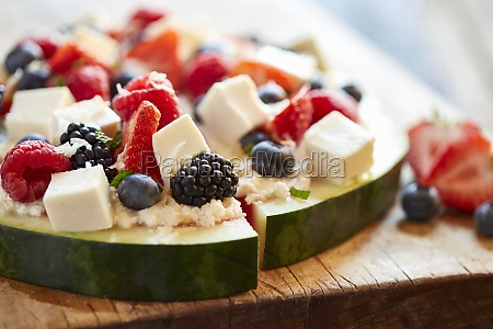 berry salad with mozzarella cheese served