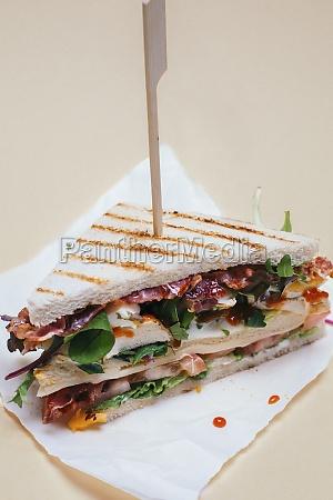 a club sandwich with chicken breast