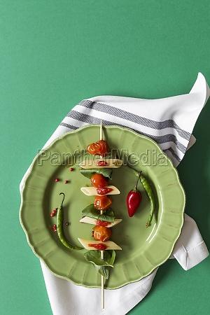macaroni with tomato sauce on green