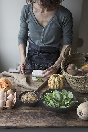 woman cutting ingredients for tasty pumpkin