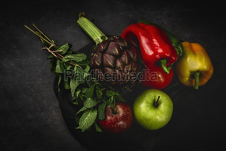 mix of fresh vegetables on black