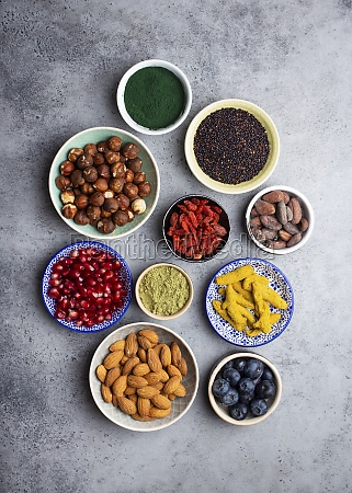 set of different superfoods in bowls