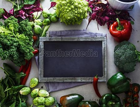 blackboard with fresh vegetables