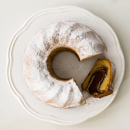 marble cake with powdered sugar sliced