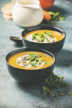 homemade pumpkin soup and ingredients