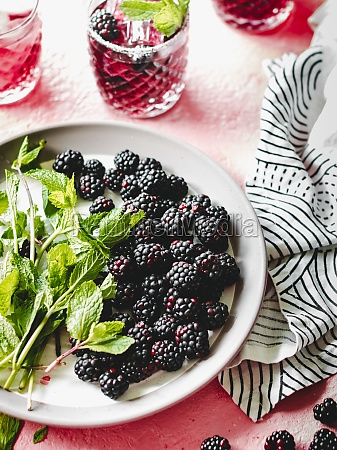 blackberries and mint leaves on the