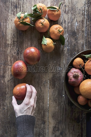 fresh citrus fruits on a wooden