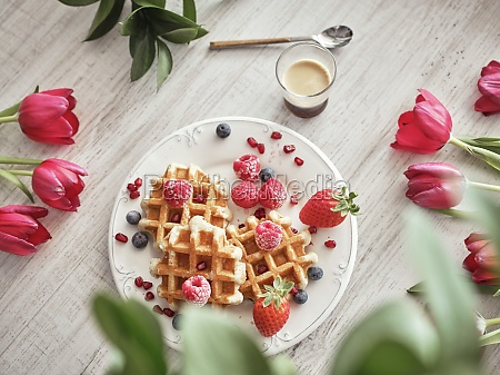 dish with delicious waffles and fresh
