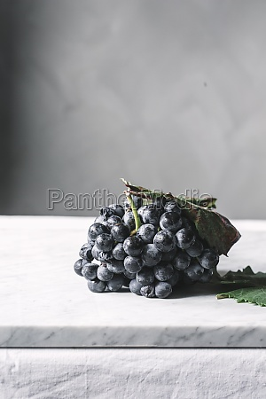 bunch of grapes on plate