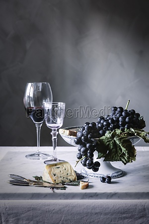 grapes and wine on table