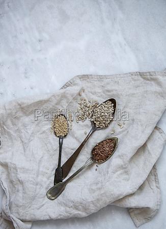 sesame sunflower flax seeds on marble