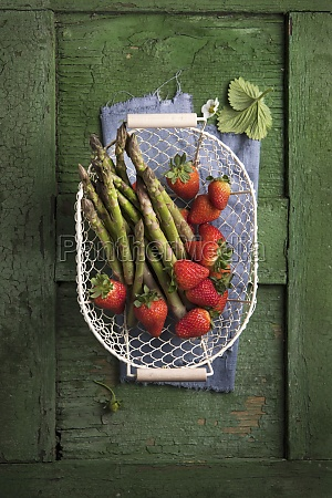 asparagus and strawberries in a wire