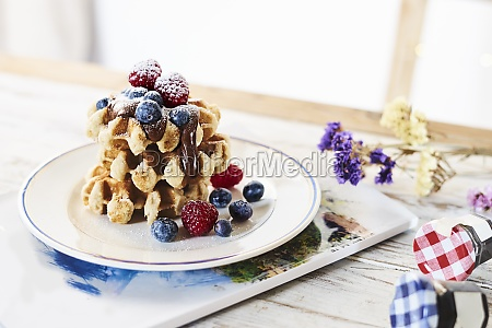 plate with stack of golden waffles