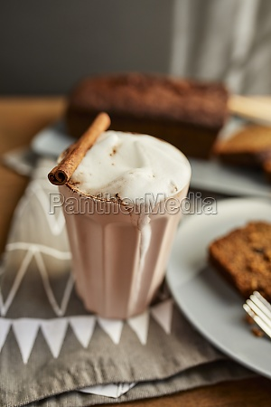 cappuccino with cocoa and cinnamon stick
