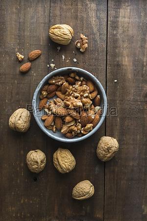 walnuts and almonds in a ceramic