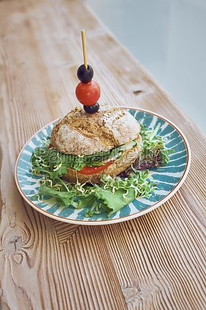 vegetarian sandwich with tomatoes onion lettuce