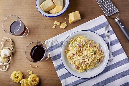 homemade pasta carbonara with parmesan cheese