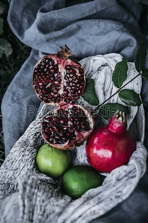 various fruits lying on fabric on