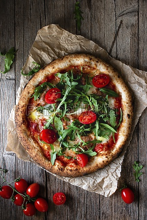 delicious pizza with tomato and salad