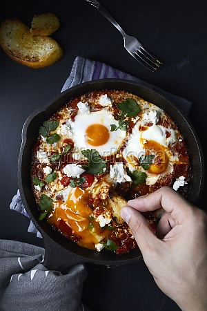 shakshuka with tomatoes peppers onions and
