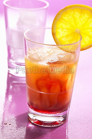 a tequila sunrise made with lemon