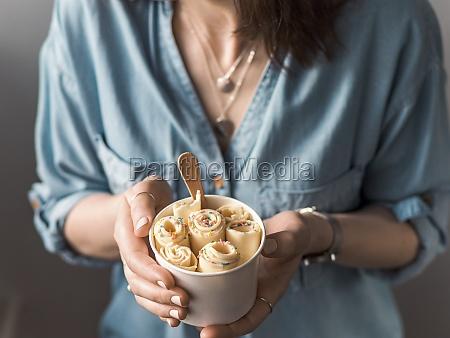 vanilla rolled ice cream in cone
