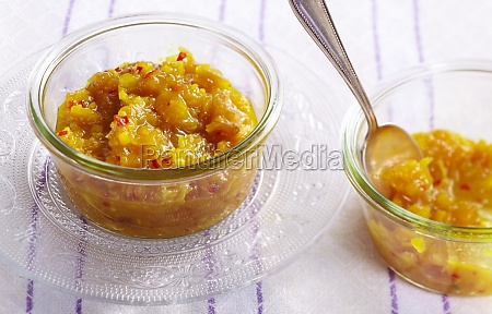 tangy peach chutney in glass bowls