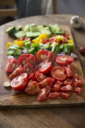 chopped gazpacho vegetables on a wooden