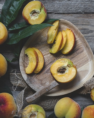 wooden plate with peaches peaches with