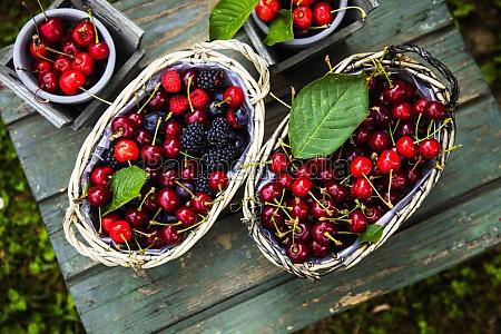 fresh organic cherries blueberries and blackberries