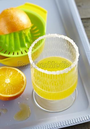 poncha cocktail with orange lemon honey
