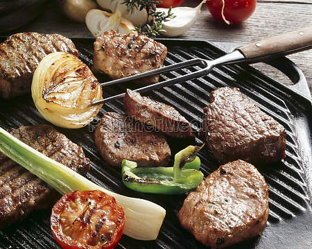 various meats and vegetables on a