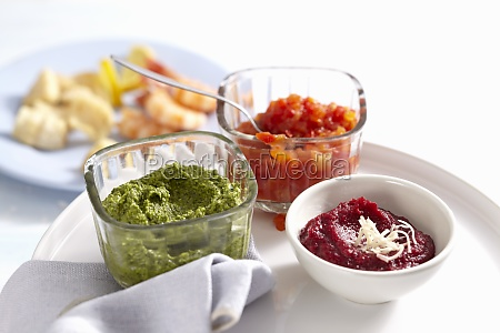 bowls of various sauces for a